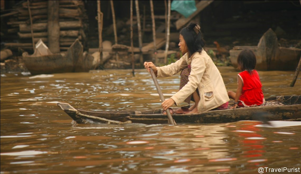 woman rowing on the Tonlé Sap, Tonlé Sap, Cambodian woman, mother and child, floating village, boat, Khmer culture, Siem Reap, Cambodia, villages of Cambodia, rural Cambodia, freshwater lake, living on a Lake, Kampong Khleang, communities of Cambodia, community, travel, South East Asia, Asia