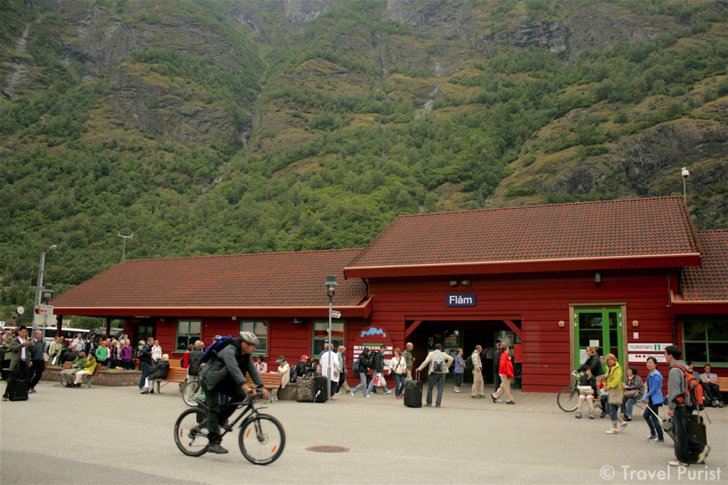 Flåm Railway Station, passengers at a railway station, cyclist, Norway in a Nutshell, Flåm Railway, Flåm, train, travellers, Sognefjord, Fjords, Visit Norway, Norwegian culture, landscapes, hill station, trip, journey, train journey, train ride, travel, Norway, Scandinavia, Nordic, travel